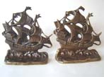 click to view detailed description of A fine pair of solid brass bookends circa 1920 depicting a 17th century Galleon