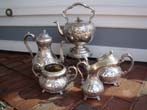 click to view detailed description of A beautiful 19th century Sheffield plate 5 piece tea and coffee service circa 1840