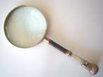 click to view detailed description of An antique Magnifying Glass with a Mother-of-pearl and gilt brass handle circa 1890
