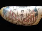 click to view detailed description of An attractive Liberty themed sag harbor style scrimshawed whales tooth depicting a soldier flanked by a pair of cannons with four American flags in the background