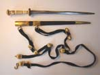 click to view detailed description of A virtual mint condition British naval dirk with gilt brass mounts complete with straps and buckles by