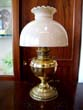 click to view detailed description of A 19th century Bradley & Hubbard oil lamp, now converted to electricity