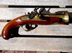 click to view detailed description of A beautiful 18th century Naval officers flintlock brass barreled blunderbuss pistol with snap bayonet by James Daniel of Birmingham circa 1780-1790.