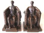 click to view detailed description of The finest pair of Antique 'Lincoln in the chair' Bookends by Jennings Brothers circa 1922