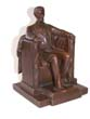 click to view detailed description of A Wonderful Single Antique Bookend of Lincoln sitting in the chair at the Lincoln Memorial circa 1925.