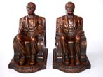 click to view detailed description of A Beautiful pair of Antique Bookends circa 1924 depicting Lincoln sitting in the chair.
