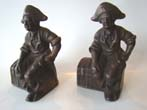 click to view detailed description of A pair of 'Pirate Sitting on a Treaure Chest' cast iron bookends by Hubley circa 1915