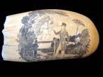 click to view detailed description of A highly detailed and beautiful 19th century scrimshaw whale's tooth circa 1840