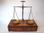 click to view detailed description of A lovely set of antique jewelers scales mounted on a fruitwood base circa 1860