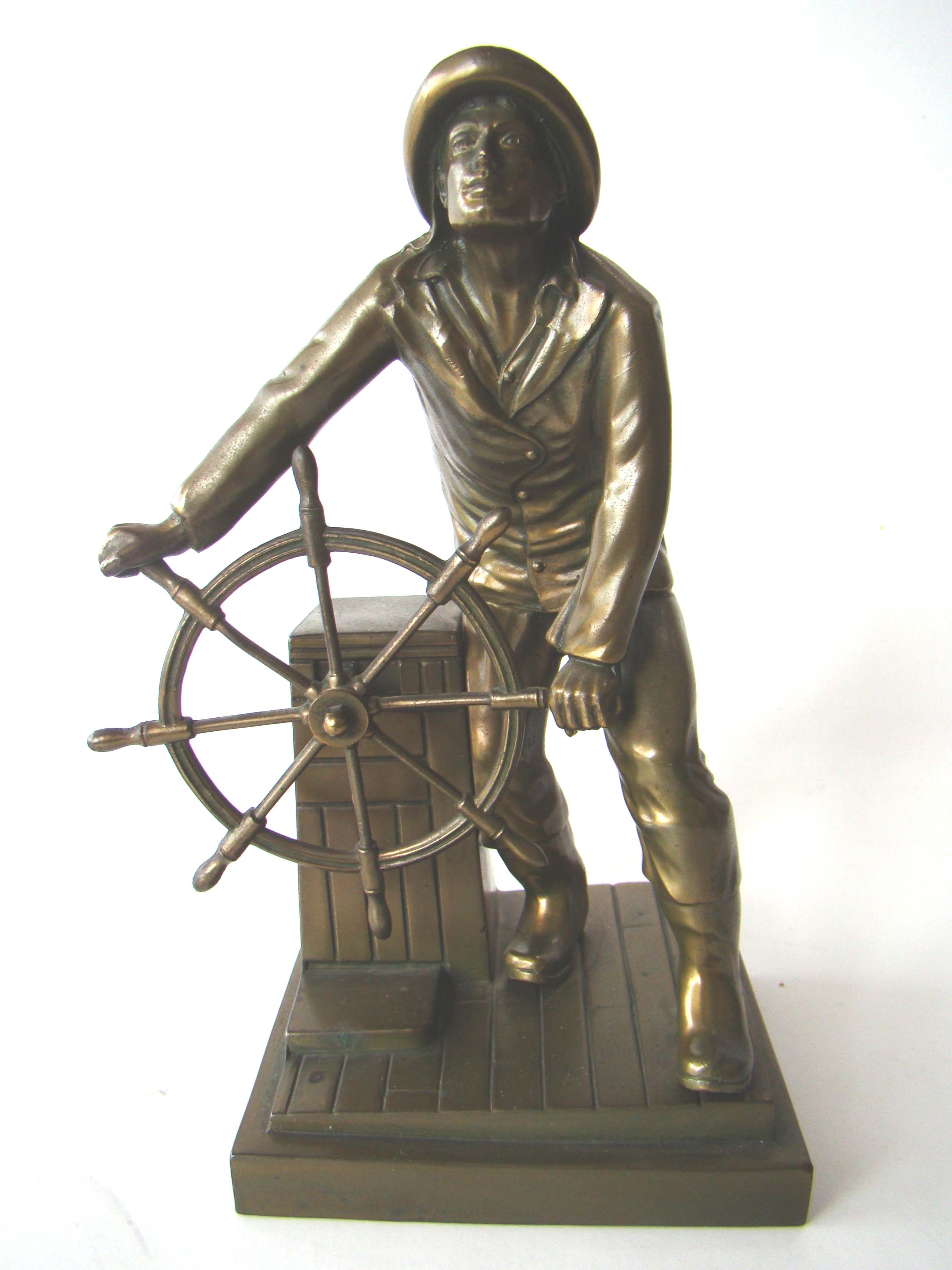 click to view detailed description of A fine single bookend depicting the statue of the Gloucester Fisherman circa 1928