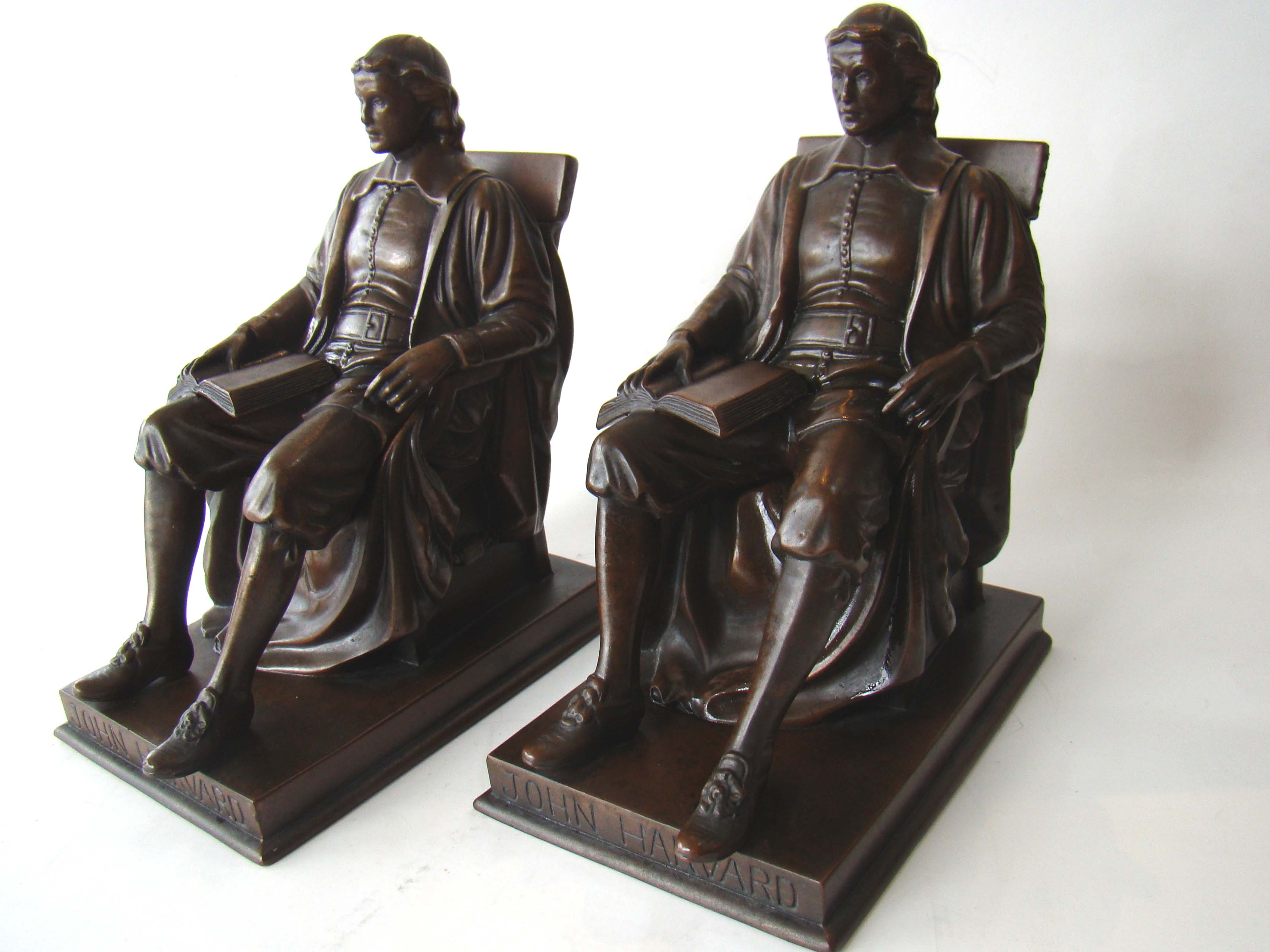 click to view detailed description of An extremely fine pair of John Harvard bookends circa 1930
