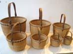 click to view detailed description of A wonderful vintage nest of seven Nantucket baskets circa 1970