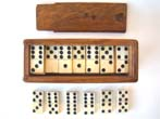 click to view detailed description of A fine set of solid bone antique 19th century dominoes in the original box