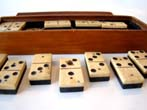 click to view detailed description of A complete set of Civil War era (circa 1865) bone and ebony dominoes.
