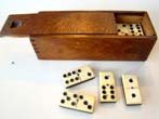 click to view detailed description of A very nice set of late 19th century bone and ebony dominoes