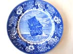 click to view detailed description of A souvenir plate circa 1935 depicting the Mayflower arriving in Provincetown Harbor