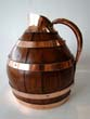 click to view detailed description of An English copper bound oak cider jug circa 1870