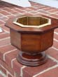 click to view detailed description of A GORGEOUS  English octagonal shaped mahogany planter or wine cooler with brass liner circa 1870.