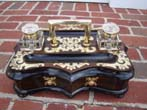 click to view detailed description of A magnificent English brass mounted coromandel wood inkstand circa 1860