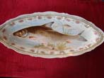 click to view detailed description of A beautiful Austrian bone china serving platter circa 1880-1900 with hand painted depiction of a salmon