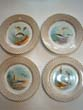 click to view detailed description of A beautiful set of four hand painted Limoges bone china fish plates circa 1900