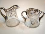 click to view detailed description of An attractive vintage silver overlay creamer & sugar made circa 1900
