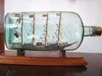 click to view detailed description of A rare and large antique four-masted ship-in-a bottle circa 1880-1900