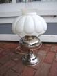 click to view detailed description of An attractive late 19th century American oil lamp with polished nickel silver base