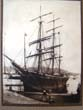click to view detailed description of An original 19th century sepia photograph of an American ship tied up at a wharf circa 1860-1880