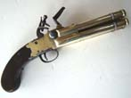 click to view detailed description of A Unique large 18th century brass barrel tap action four barrel flintlock volley pistol