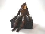click to view detailed description of Pirate sitting on a treasure chest by J B Hirsch circa 1925