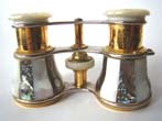 click to view detailed description of A magnificent pair of antique French opera glasses mounted with abalone and mother-of-pearl circa 1890