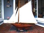 click to view detailed description of A fine large vintage plank-on-frame Pond Boat