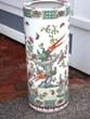click to view detailed description of An extremely attractive and rare Chinese porcelain exotic birds and butterfles motif umbrella stand, 20th century