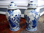 click to view detailed description of An attractive pair of Chinese TEMPLE jars with exotic bird motif, 20th century