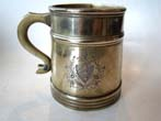 click to view detailed description of A late 18th or early 19th century English brass 1/2 pint tankard with coat-of-arms