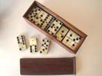 click to view detailed description of A fine boxed set of Civil War bone and ebony dominoes circa 1865