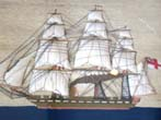 click to view detailed description of A charming 19th century sailor-made woolwork picture of a British steam and sail ship circa 1865 in what appears to be its' original frame.