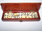 click to view detailed description of A 19th century miniature cased set of dominoes