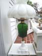 click to view detailed description of A very attractive 19th century oil lamp mounted in emerald green and milk glass circa 1875