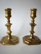 click to view detailed description of A fine pair of English Georgian brass candlesticks circa 1720-1740.