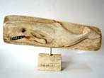 click to view detailed description of A wonderful carved whalebone depiction of a sperm whale dated July 4, 1897