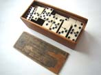click to view detailed description of A boxed set of Civil War era bone and ebony dominoes circa 1860-1870