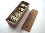 click to view detailed description of A nice boxed set of Civil War era bone and ebony dominoes circa 1860-1870