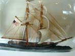 click to view detailed description of A very well made and attractive Two-Masted Ship-in-a Bottle