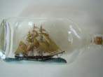 click to view detailed description of A very fine and attractive Three-Masted Ship-in-a Bottle
