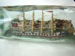 click to view detailed description of A Wonderful Antique Ship-in-a Bottle being lead into harbor by a pilot boat circa 1900