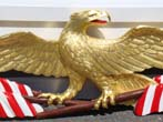 click to view detailed description of A Patriotic carved American Eagle with flag banners