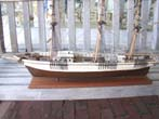 click to view detailed description of An antique model of the three-masted ship SAM SKOLFIELD built at Brunswick, Maine, in 1883