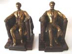 click to view detailed description of A pair of vintage bronze and brass finished Abraham Lincoln